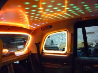 Disco lights in a taxi cab ... Yeah Baby! Hire